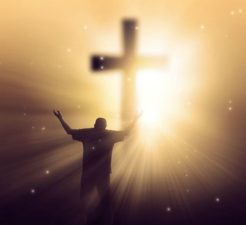 God's Light at the Cross of Jesus Christ Shines in the Heart of a Man Giving Thanks and Praise