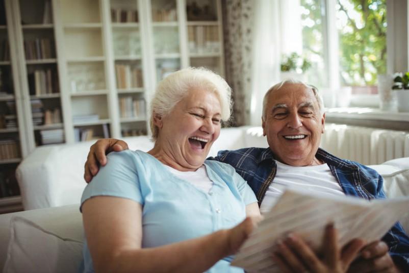 Older Couple Enjoying Family Photos