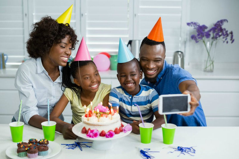 Young Family Creating Birthday Memories