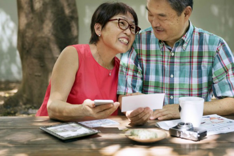 Older Couple Enjoying Family Memories